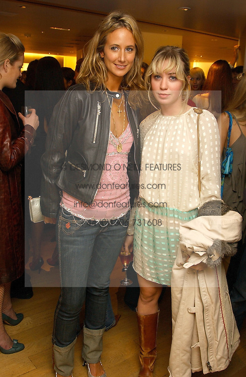 Left to right, LADY VICTORIA HERVEY and MISS ANOUSKA GERHAUSER daughter of Tamara Beckwith  at a party hosted by Burberry to launch their special collection in aid of Breakthrough Breast Cancer, held at 21-23 New Bond Street, London W1 on 5th October 2004.<br /><br />NON EXCLUSIVE - WORLD RIGHTS