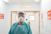 A whole theatre has been dedicated to treating Covid +ve patients for their other ailments.  Here Sara Roberts ODP (Operating Department Practitioner) is seen in the doffing room where Covid contaminated PPE is removed before entering the clean zones of the unit.<br /> <br /> From my exhibition series for  Betsi Cadwaladr via the Betsi Research Unit.<br /> <br /> My brief was not frontline action as seen on all news outlets, but the way hospitals & staff have adapted to cope with the crisis, from PPE to social distancing & also those vital behind the frontline workers essential throughout the crisis to support frontline NHS staff.<br />  <br /> A small touring exhibition will be open to the public when safer times permit.