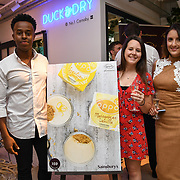 Lou, Trinity and Maria Jordan from the Oppo party to launch its new Madagascan Vanilla, Sicilian Lemon and Raspberry Cheesecakes, served with Skinny Prosecco at Farm Girls Café, 1 Carnaby Street, Soho, London, UK on July 18 2018.