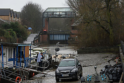 © Licensed to London News Pictures. 03/01/2016. York, UK. A man carries clothes from a barge close to the Foss Barrier in York. Photo credit : Anna Gowthorpe/LNP