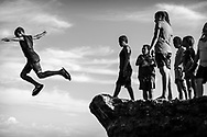 Young Papua New Guineans enjoy a Sunday afternoon swimming and jumping in the sea at Machine Gun Beach in the town of Madang, Papua New Guinea.<br /><br />(August 6, 2017)