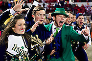 NORMAN, OK - OCTOBER 27:   Cheerleaders and Mascot of the Notre Dame Fighting Irish celebrate after a touchdown against the Oklahoma Sooners at Gaylord Family Oklahoma Memorial Stadium on October 27, 2012 in Norman, Oklahoma.  The Fighting Irish defeated the Sooners 30-13.  (Photo by Wesley Hitt/Getty Images) *** Local Caption *** Sports photography by Wesley Hitt photography with images from the NFL, NCAA and Arkansas Razorbacks.  Hitt photography in based in Fayetteville, Arkansas where he shoots Commercial Photography, Editorial Photography, Advertising Photography, Stock Photography and People Photography