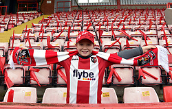 A young Exeter City fan shows this support in the stands prior to the FA Cup, third round match at St James' Park, Exeter.