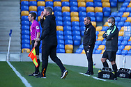 AFC Wimbledon manager Mark Robinson stood in technical area during the EFL Sky Bet League 1 match between AFC Wimbledon and Hull City at Plough Lane, London, United Kingdom on 27 February 2021.