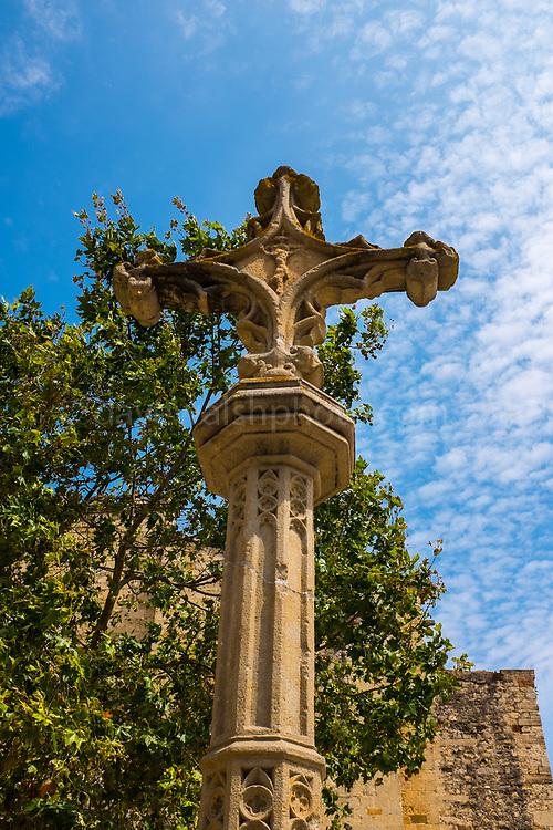 Cross outside the 9th century Monestir de Sant Cugat del Valles, near Barcelona, Catalonia.