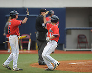 Ole Miss' Holt Perdzock (42) scores in the 7th inning and celebrates with Will Jamison (4) vs. Lipscomb at Oxford-University Stadium in Oxford, Miss. on Sunday, March 10, 2013. Ole Miss won 9-8. The Rebels improve to 16-1.