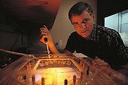 Research on the human genome: Caltech scientist Leroy Hood preparing an electrophoresis gel used in a computer-controlled system for DNA sequencing of human chromosomes. DNA sequencing involves decoding the base pair sequence of sections of DNA encode specific proteins. Sequencing and mapping chromosomes to locate genes or other important markers - are two phases in the human genome project. The human genome is a complete genetic blueprint - a detailed plan of every gene expressed on all 23 pairs of chromosomes. MODEL RELEASED (1989).