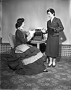 19/03/1958<br /> 03/19/1958<br /> 19 March 1958<br /> Remington reception, Office Efficiency exhibition at Royal Hibernian Hotel. Hostess in 'period ' costume, with colleague in uniform.