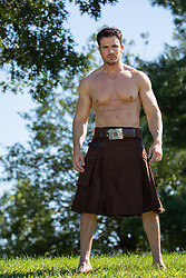 muscular man in a kilt outdoors shirtless muscular man in a kilt outdoors