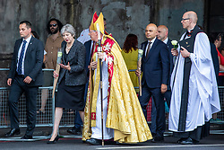 © Licensed to London News Pictures. 03/06/2018. London, UK. Prime Minister Theresa May (2-L), Bishop of Southwark Christopher Chessun (3-L) and Home Secretary Sajid Javid (4-L) walk from Southwark Cathedral to London Bridge to lay flowers and observe a minute's silence to mark the first anniversary of the London Bridge and Borough Market terror attack. Photo credit: Rob Pinney/LNP