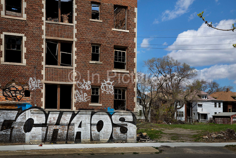 """Graffiti on deserted buildings on Grand River Detroit. Known as the world's traditional automotive center, """"Detroit"""" is a metonym for the American automobile industry and an important source of popular music legacies celebrated by the city's two familiar nicknames, the Motor City and Motown. Many neighborhoods remain distressed since the collapse of the motor industry. The state governor declared a financial emergency in March 2013, appointing an emergency manager. On July 18, 2013, Detroit filed the largest municipal bankruptcy case in U.S. history."""