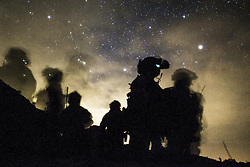 Apr 27, 2017 - Yuma, Arizona, U.S. - Night Raiders. Marines await departure during a weapons and tactics instructors course final exercise near Yuma, Arizona, April 27, 2017. The Marines are assigned to the 1st Marine Raider Battalion, Marine Raider Regiment, Marine Corps Forces Special Operations Command. Marine Corps photo by Lance Cpl. Clare Shaffer. (Credit Image: ? Clare Shaffer/Marine Corps/DoD via ZUMA Wire/ZUMAPRESS.com)