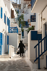Woman in black walking in Mykonos, Greece
