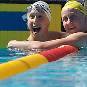 Mary Descenza, USA, (left) breaks the world record swimming next to Jessicah Schipper, Australia, in the Women's 200m Butterfly heats at the World Swimming Championships in Rome on Wednesday, July 29, 2009. Photo Tim Clayton