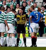 Photo. Jed Wee, Digitalsport<br /> Glasgow Celtic v Glasgow Rangers, Scottish FA Cup, Celtic Park, Glasgow. 07/03/2004.<br /> Referee Hugh Dallas (C) tries to keep the peace between the two Glasgow factions.