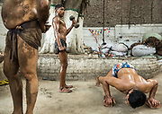 Pehlwans practice in an akhara, or outdoor earthen pit, on the edge of Lahore's Walled city. Wrestlers practicing in Lahore - a traditional sport called Kuchti. Players are called Pehlwani.