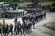 29 MAY 2014 - BANGKOK, THAILAND: Thai police and military march through Victory Monument. After a series of protests around Victory Monument earlier in the week, the Thai army Thursday shut down vehicle access to the area, one of the main intersections in Bangkok, and kept people out of the area. Thousands of soldiers surrounded the Monument and effectively locked the area down. There were no protests at Victory Monument for the first time in the week since the coup deposed the elected civilian government.   PHOTO BY JACK KURTZ