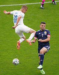 Czech Republic's Tomas Soucek and Scotland's John McGinn (right) battle for the ball during the UEFA Euro 2020 Group D match at Hampden Park, Glasgow. Picture date: Monday June 14, 2021.