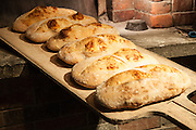 Jamestown, RI - 7 May 2007. Fresh Asiago cheese bread from the oven at The Village Hearth Bakery and Cafe.