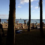 Honolulu, HI, July 18, 2007: Beach goers enjoy Waikiki Beach as the day draws to a close. (Photograph by Todd Bigelow/Aurora)