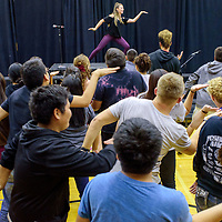 Taylor Lane teaches dance moves to students during the Young Americans summer camp at Crownpoint High School Thursday.