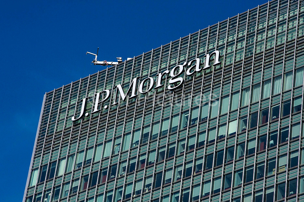 Street view of the top of the J.P. Morgan office building at 20 Bank Street, Canary Wharf, London, England, United Kingdom.