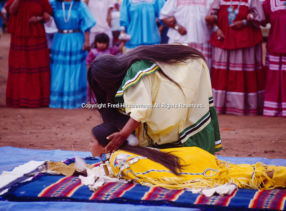 Godmother Phoebe Cromwell molding Carla Goseyun during Carla's White Mountain Apache Traditional Sunrise Ceremony, Whiteriver, Arizona.  Please Note: A small extra licensing fee needs to be paid to the Goseyun Family for usage of this photo. Contact Fred Hirschmann for more information. Thanks.