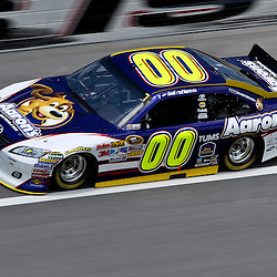 April 16, 2011; Talladega, AL, USA; NASCAR Sprint Cup Series driver David Reutimann (00) during qualifying for the Aarons 499 at Talladega Superspeedway.   Mandatory Credit: Derick E. Hingle