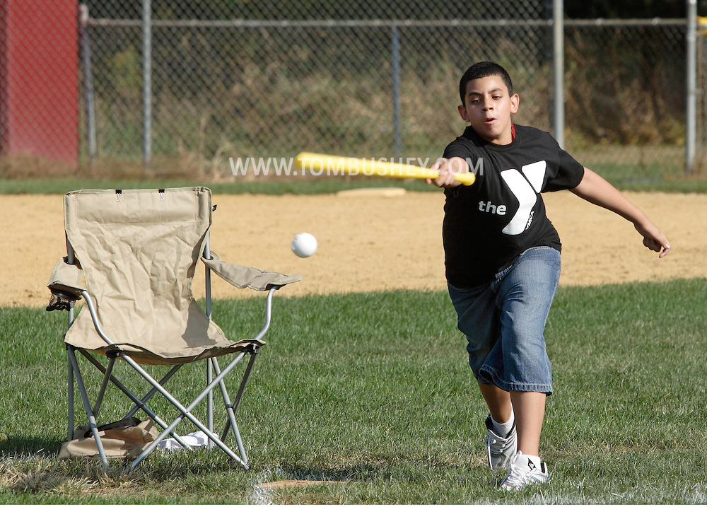 Scotchtown, New York - A player swings at a pitch in the Wiffle for Kids charity Wiffle Ball tournament at the Town of Wallkill Little League fields on Sept. 25, 2010. The annual event is run by the Wallkill East Rotary.