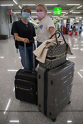 © Licensed to London News Pictures.  30/06/2021. Palma de Mallorca, Spain. Claudia and Niamh from Southend arrive at Palma Airport in Mallorca as Balearic Islands are on the UK 'green list' from 4am, today. Photo credit: Marcin Nowak/LNP