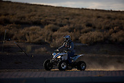 Photo by Steven St. John..An ATV rider near the site where investigators are searching for additional human remains on the southwestern outskirts of Albuquerque, N.M. at the site of a planned residential subdivision. Investigators and forensics experts are searching the crime scene where the remains of at least 13 bodies have been uncovered. The discovery has opened up cases involving missing prostitutes, some of whom vanished as much as 20 years ago.