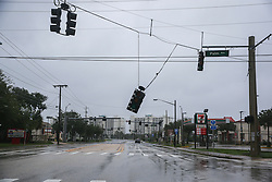 October 7, 2016 - Titusville, Florida, U.S. - A stoplight, damaged by Hurricane Matthew winds, dangles just above the roadway along Pine Avenue. (Credit Image: © Will Vragovic/Tampa Bay Times via ZUMA Wire)