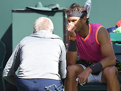 March 15, 2019 - Indian Wells, CA, U.S. - INDIAN WELLS, CA - MARCH 15:  Rafael Nadal (ESP) talking to the ATP trainer after the 3rd game of  the second set where he defeated Karen Khachanov (RUS) in the men's singles quarterfinal on March 15, 2019, during the BNP Paribas Open at the Indian Wells Tennis Garden in Indian Wells, CA. (Photo by Cynthia Lum/Icon Sportswire) (Credit Image: © Cynthia Lum/Icon SMI via ZUMA Press)