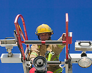photo Randy Vanderveen, .Grande Prairie, Alberta.Grande Prairie firefighter Chad Cormack checks the ladder and its controls on one of the fire department's ladder trucks during a weekly thorough inspection.