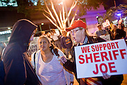 """Nov. 30, 2009 -- PHOENIX, AZ: A supporter of Sheriff Joe Arpaio shouts at an anti sheriff protestor at the Walter Cronkite School of Journalism and Mass Communication at Arizona State University in Phoenix, AZ. The event was billed as a """"Meet the Press"""" type interview with controversial Maricopa County Sheriff Joe Arpaio. Arpaio was questioned by three members of the faculty, all former journalists. About 3/4 of the way through the one hour program, protestors opposed to Sheriff started singing and effectively shut down the program forcing the sheriff to leave early. Several hundred protestors, both opposed to and supporting the sheriff, picketed the front of the school during the program.   Photo by Jack Kurtz"""