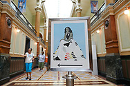 WASHINGTON - JUNE 29, 2019: A sign points the way for visitors to find a painting of the official portrait of First Lady Michelle Obama by artist Amy Sherald on June 29, 2019, at the National Portrait Gallery in Washington, D.C.