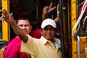 "10 JANUARY 2007 - MANAGUA, NICARAGUA: Sandanista supporters from rural Nicaragua arrive in Managua to participate in the inauguration of Daniel Ortega Wednesday. Ortega, the leader of the Sandanista Front, was sworn in as the President of Nicaragua Wednesday. Ortega and the Sandanistas ruled Nicaragua from their victory of ""Tacho"" Somoza in 1979 until their defeat by Violetta Chamorro in the 1990 election.  Photo by Jack Kurtz"