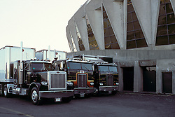 A row of G. D. Productions Big Rig Trucks parked in back of the Hampton Coliseum. Scenes before the Second Warlocks Show. The Grateful Dead Live at The Hampton Coliseum 9 October 1989