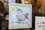 "A poster in a shop window saying ""Wrens Accepted Here. Money that stays in Wadebridge"".  Wrens are a local currency developed by Wadebridge Renewable Energy Network (WREN) to support local businesses."