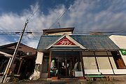 An empty shop in the abandoned village of Tsushima in Fukushima, Japan. Friday May 4th 2012. After the explosions at the Daichi nuclear plant caused by the March 11th 2011 earthquake and tsunami, High levels of radioactive contamination in this village have made it uninhabitable.