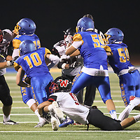 (Photograph by Bill Gerth/ for SVCN/9/1/17) Westmont #9 Gage Reitz makes a diving tackle vs Prospect #10 Nate Nathanson in a preseason football game at Prospect High School, Saratoga CA on 9/1/17. (Westmont 20 Prospect 0)