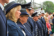 Left to right, Claudia Borecky and Debra Bernhardt, Auxiliary members of Merrick Post 1282 American Legion, at Merrick Fire Department ceremony commemorating 10th Anniversary of 9/11, held at corner of Merrick Avenue and Sunrise Highway, in Merrick, New York, USA, on September 11, 2011.