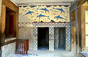 """A modern copy of the ancient Minoan dolphin fresco is installed in place of the original dating from 1500 BC at Knossos palace, Heraklion (Iraklion), Crete, Greece, Europe. Knossos is a Minoan archeological site associated with the Labyrinth and Minotaur of Greek mythology. The Bronze Age palace of Knossos was first built around 1900 BC, destroyed by a large earthquake or foreign invaders in 1700 BC, rebuilt more grandly, then damaged several more times by earthquakes, by invasions, and in 1450 BC by the colossal volcanic eruption of Thera (modern Thira or Santorini). Invading Mycenaeans used Knossos as their capital as they ruled the island of Crete until 1375 BC. Archaeologist Arthur Evans excavated the Palace at Knossos from 1900-1905 and named the Minoan civilization of Crete after king Minos from Greek mythology. Homer's epic poems of the Iliad and Odyssey are the first Greek literature to mention Minos as a king of Knossos, Crete. Minos was son of Zeus and Europa. Every nine years Minos made King Aegeus pick seven men and seven women to go to the Labyrinth to be eaten by the Minotaur, a creature half man and half bull. After his death, legendary Minos became a judge of the dead in Hades. The vast building complex at Knossos is popularly thought to be the site of the Labyrinth, which Greek mythology says was designed by architect Daedalus with such complexity that no one could ever find its exit. Published by Thames & Hudson Ltd in the book """"Art and Archaeology of the Greek World"""" by Richard Neer 2012."""