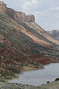 SHOT 6/8/16 12:38:19 PM - Flaming Gorge Reservoir straddles the Utah-Wyoming border and was completed in 1964. The reservoir is mainly in southwest Wyoming and partially in northeastern Utah. The northern tip of the reservoir is 10 miles southeast of Green River, Wyoming, 14 miles southwest of Rock Springs, Wyoming, and 43 miles north of Vernal, Utah. Visitors enjoy world class fishing, hiking, boating, windsurfing, camping, backpacking, cross-country skiing, and snowmobiling within Flaming Gorge National Recreation Area, which is operated by Ashley National Forest. (Photo by Marc Piscotty / © 2016)