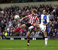 Photo. Glyn Thomas<br />Blackburn Rovers v Southampton. FA Barclaycard Premiership.<br />Ewood Park, Blackburn. 08-02-2003.<br />Southampton's James Beattie (L) takes the ball round Lucas Neill
