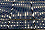 """Solar panels outside Kuzumaki Junior High School. Kuzumaki in Northern Japan bills itself as a town of """"Milk, wine and clean energy"""". The 8000 population town has little local industry so Kuzumaki invited Japanese companies to set up wind, solar and biogas generating plants."""