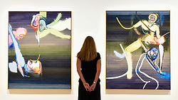 """© Licensed to London News Pictures. 04/09/2018. LONDON, UK. A staff member views (L to R) """"Interior Living"""", and """"In the secret room where now"""", both 2018, at a preview of an exhibition called """"I Should Have Known Better"""" by German artist Daniel Richter at Galerie Thaddaeus Ropac in Mayfair.  The exhibition runs 5 to 28 September 2018.  Photo credit: Stephen Chung/LNP"""