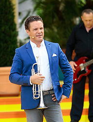 "14.06.2015, Europapark, Rust, GER, ARD TV Show, Immer wieder Sonntags, im Bild Stefan Mross mit Trompete // during the ARD TV Show ""Immer wieder Sonntags"" at the Europapark in Rust, Germany on 2015/06/14. EXPA Pictures © 2015, PhotoCredit: EXPA/ Eibner-Pressefoto/ Goermer<br /> <br /> *****ATTENTION - OUT of GER*****"