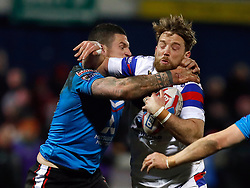 Wakefield Trinity's Danny Kirmond is tackled by Salford Red Devils' Luke Burgess (left) during the Betfred Super League match at Belle Vue Stadium, Salford.