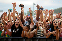24 April 2016. New Orleans, Louisiana.<br /> The New Orleans Jazz and Heritage Festival. <br /> Fans scream for J Cole at the Congo Square stage.<br /> Photo; Charlie Varley/varleypix.com